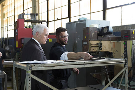 V.P. Pence with Tendon Manufacturing employee Dakota Saliga in Cleveland, Ohio.